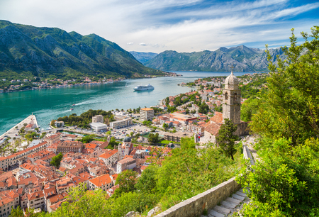 Foto de Classic panorama view of the historic Church of Our Lady of Remedy overlooking the old town of Kotor and world-famous Bay of Kotor, Montenegro, southern Europe. - Imagen libre de derechos