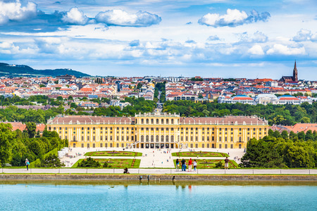 Photo for Classic view of famous Schonbrunn Palace with scenic Great Parterre garden on a beautiful sunny day with blue sky and clouds in summer, Vienna, Austria - Royalty Free Image