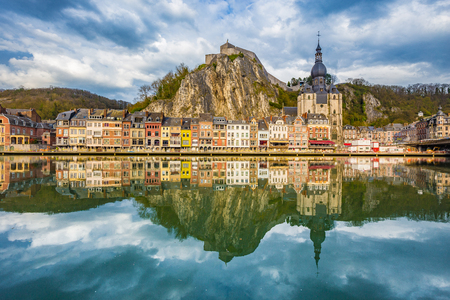 Foto de Classic view of the historic town of Dinant with scenic River Meuse in beautiful golden evening light at sunset, province of Namur, Wallonia, Belgium - Imagen libre de derechos