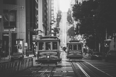 Photo pour Classic view of historic traditional Cable Cars riding on famous California Street in beautiful morning light at sunrise in summer with retro vintage B&W filter effect, San Francisco, California, USA - image libre de droit