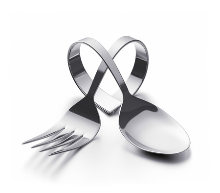 Photo for Bent spoon and fork representing a heart - Royalty Free Image
