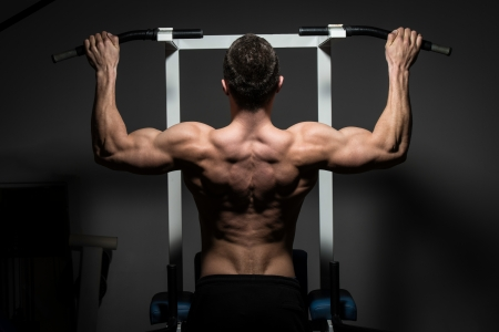 Photo for young male bodybuilder doing heavy weight exercise - Royalty Free Image