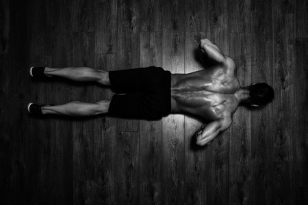 Foto de Healthy Athlete Doing Push Ups As Part Of Bodybuilding Training - Imagen libre de derechos