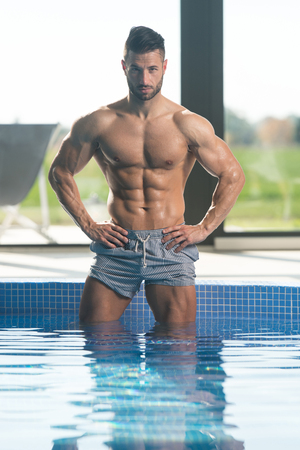 Photo for Fashion Portrait Of A Very Muscular Sexy Man In Underwear At Swimming Pool - Royalty Free Image