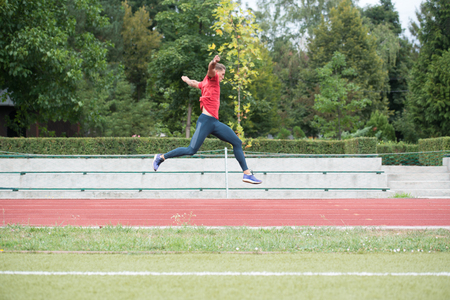 Photo for Young Athlete Man Running on Track In Park Run Athletics Race - Royalty Free Image