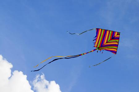 Foto de kite's colors in the cloud sky - Imagen libre de derechos