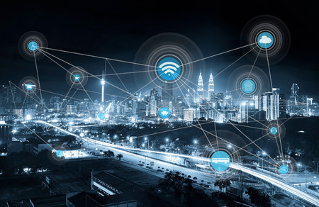 Foto de smart city and wireless communication network, abstract image visual, internet of things, mono blue tone . - Imagen libre de derechos