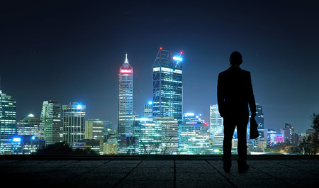 The silhouette portraitof businessman on the roof to see the scenery. Concept of vision of the future .