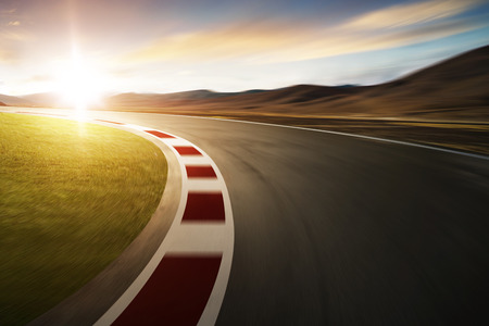 Photo pour Motion blurred racetrack with mountain background , warm mood - image libre de droit