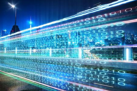 Foto de Highway flyover with binary code numbers on motion blurred asphalt  road , speed and faster digital matrix technology information concept . - Imagen libre de derechos