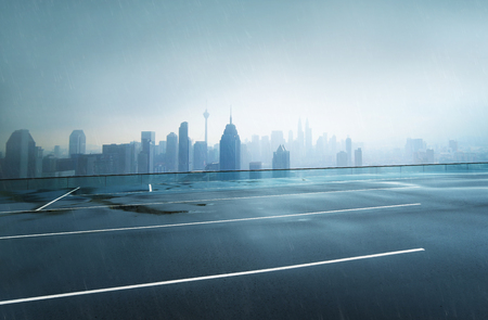 Photo pour Empty wet asphalt road with foggy city skyline background , raining day . - image libre de droit