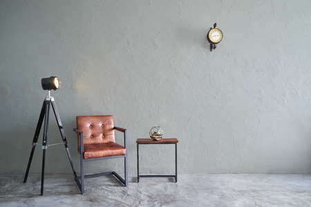 Photo for Modern living room with brown iron chair , clock ,tea table,cactus  and lamp stand. cement floor and concrete wall ,Interior design with Loft style . - Royalty Free Image