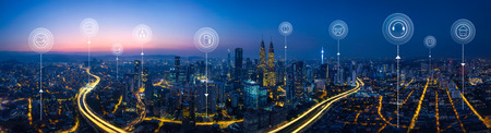 Photo pour Panorama aerial view in the  cityscape skyline  with smart services and icons, internet of things, networks and augmented reality concept , early morning sunrise scene . - image libre de droit