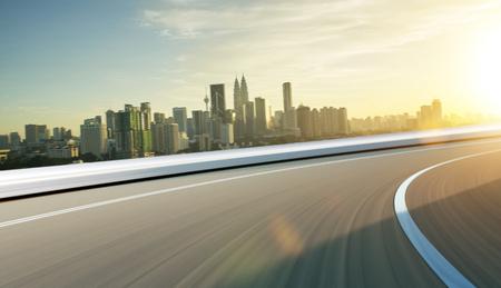 Foto de City street road  with motion blur . Morning scene .Transportation concept . - Imagen libre de derechos