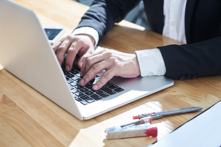 Photo for Closeup businessman using laptop to work . - Royalty Free Image