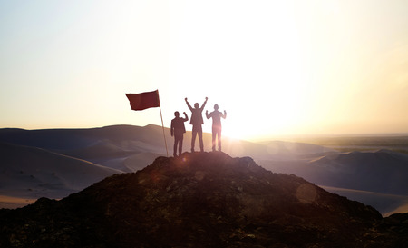 Photo pour Silhouette of the Business team on top of a mountain . Business Success and Leadership concept. - image libre de droit