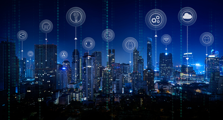 Foto de Smart city with smart services and icons, internet of things, networks and augmented reality concept ,Bangkok city night scene. - Imagen libre de derechos