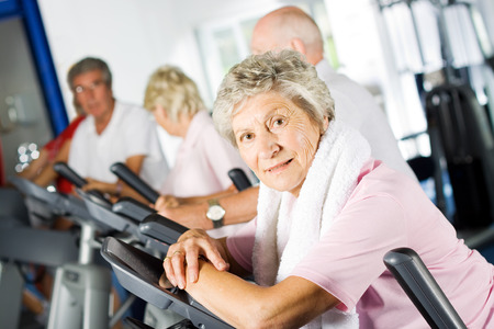 Photo for Group of older mature people exercising in the gym - Royalty Free Image