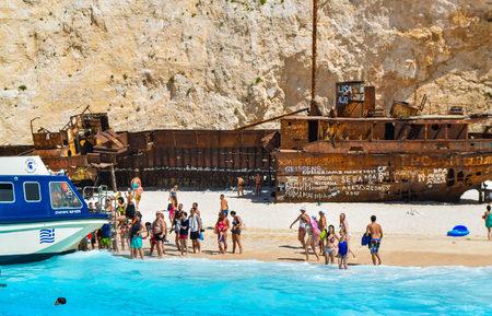 Foto de Shipwreck Bay, Zakynthos Island, Greece - July 26, 2017: Tourists on the Shipwreck Beach. - Imagen libre de derechos