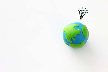Photo pour Environment conservation idea concept , earth and light bulb with plant - image libre de droit