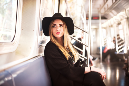Foto de Elegant fashion business woman in the metro - Imagen libre de derechos