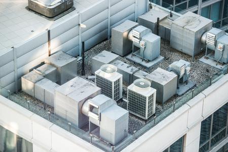 Photo pour Air condition system on the building roof toop - image libre de droit