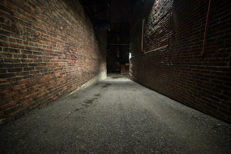 Photo for Scary empty dark alley with brick walls - Royalty Free Image
