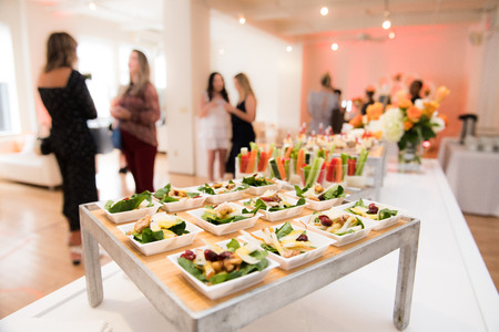 Photo pour Healthy organic gluten-free delicious green snacks salads on catering table during corporate event party - image libre de droit