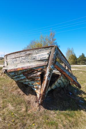 Photo for Abandoned fishing boat on sea coast. - Royalty Free Image