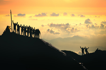 Photo for A group of people are standing on the top of the mountain. - Royalty Free Image