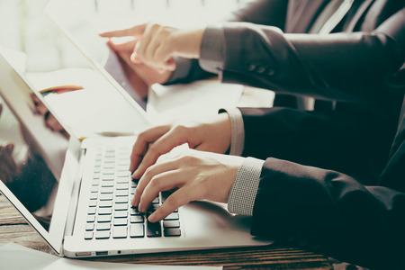 Foto de Business people meeting at office ( Filtered image processed vintage effect. ) - Imagen libre de derechos