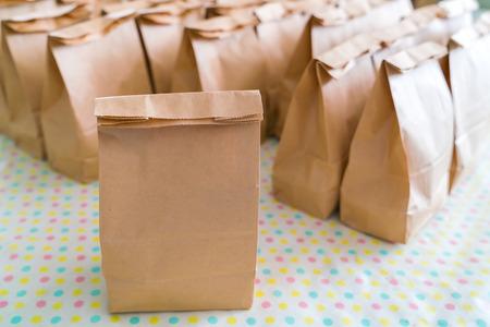 Photo pour Brown paper bags on table - image libre de droit