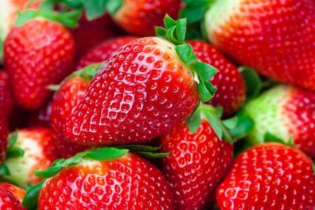 background of red big juicy ripe strawberries