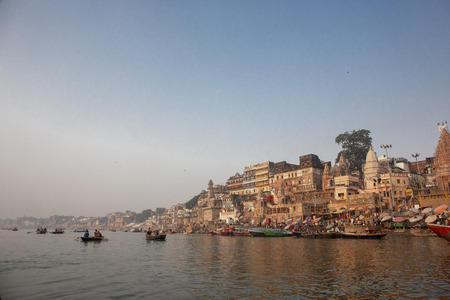 Foto de Varanasi India ancient city architecture panoramic view at sunset as seen from a boat on river Ganges, India - Imagen libre de derechos