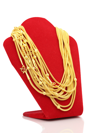 Photo for Gold necklaces on necklace display stand white background. - Royalty Free Image