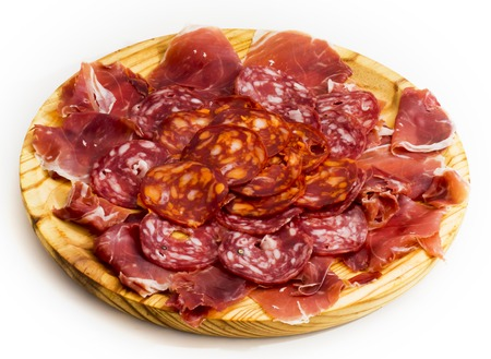 Photo for Typical spanish food with ham and sausage on a wooden plate - Royalty Free Image