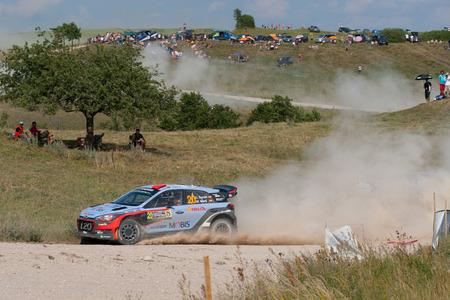MIKOLAJKI, POLAND - JUL 2: Dani Sordo and his codriver Marc Marti in a Hyundai New Generation i20 WRC race in the 73nd Rally Poland, on July 2, 2016 in Mikolajki, Poland.