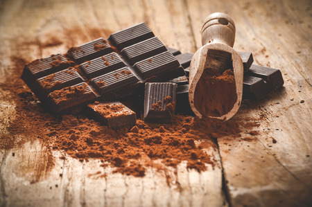 Photo for Noble dark chocolate on a wooden table in vintage style. - Royalty Free Image