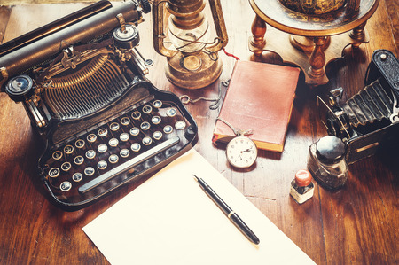 Photo pour Vintage items, camera, pen, globe, clock, typewriter on the old desk - image libre de droit