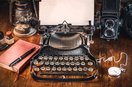 Photo for Traditional and old way of writing messages and taking photos, typewriter, camera, watch, pen, Vintage lamp on the desk - Royalty Free Image