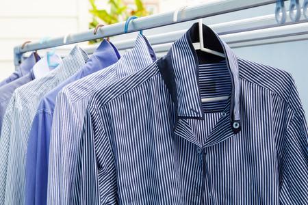 Foto de Cleaning clothes with blue shirt wait for dry-3 - Imagen libre de derechos