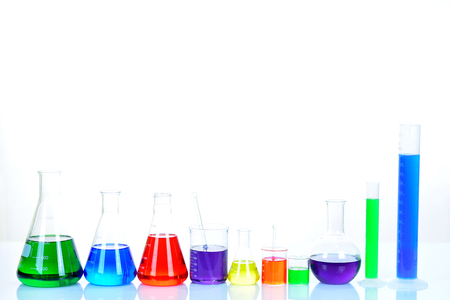 Foto de Laboratory glassware with colorful chemical reagent in research laboratory - Imagen libre de derechos