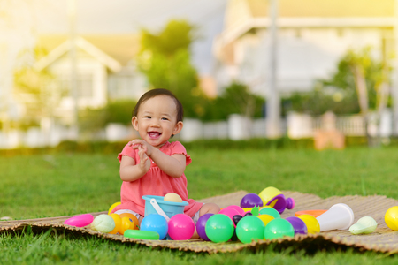 Photo pour Cute Asian baby playing with toys and smile in playground - image libre de droit