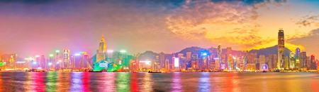 Photo pour Victoria Harbor and Hong Kong skyline at sunset. - image libre de droit