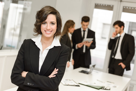 Photo pour Image of businesswoman leader looking at camera in working environment  - image libre de droit