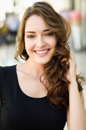 Photo for Beautiful young woman with blue eyes smiling in urban background. Girl wearing summer clothes - Royalty Free Image