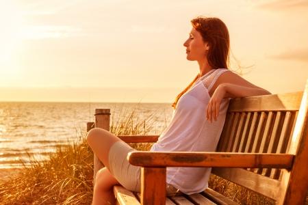 Foto de relaxing female on sundown coast  - Imagen libre de derechos