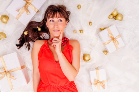 Photo for thinking gifts online shopping girl  - Royalty Free Image