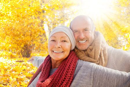 Foto de smiling retirement happiness in forest - Imagen libre de derechos