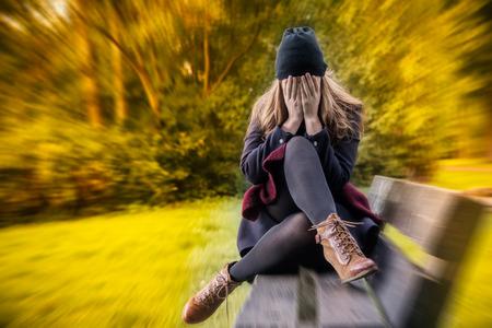Foto de depressed female in autumn season - Imagen libre de derechos